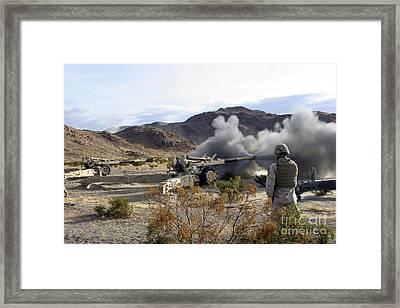 An M198 Howitzer Fires A 155-millimeter Framed Print by Stocktrek Images