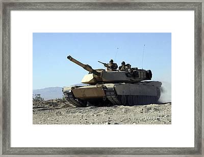 An M1a1 Main Battle Tank Framed Print by Stocktrek Images