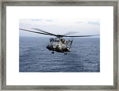 An Mh-53e Sea Dragon In Flight Framed Print by Stocktrek Images