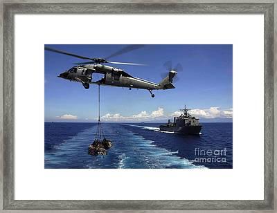 An Mh-60s Knighthawk Transports Cargo Framed Print