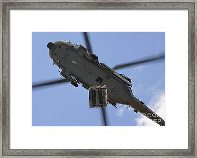 An Mh-60s Seahawk Helicopter Airlifts Framed Print