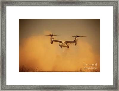 An Mv-22 Osprey Aircraft Blows Dust Framed Print