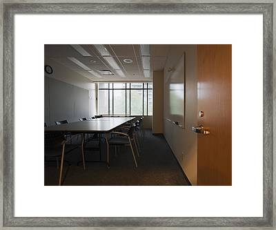 An Office Interior. Door Open To Empty Framed Print by Marlene Ford