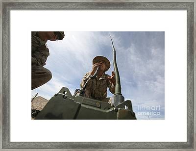 An Officer Conducts A Radio Check Framed Print by Stocktrek Images