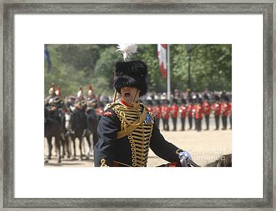An Officer Shouts Commands Framed Print by Andrew Chittock