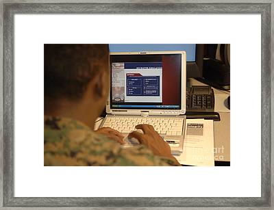 An Officer Works On A Tablet Pc Framed Print by Stocktrek Images