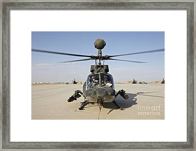An Oh-58d Kiowa Helicopter Prepares Framed Print by Terry Moore