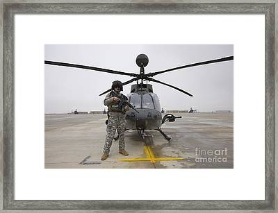 An Oh-58d Kiowa Warrior Pilot Stands Framed Print by Terry Moore