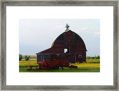 an old barn and bailor in Eastern Montana Framed Print by Jeff Swan