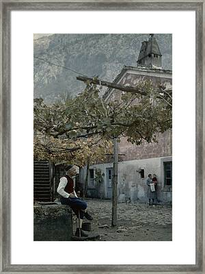 An Old Man Sitting Under His Grape Framed Print by Wilhelm Tobien