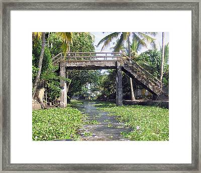 An Old Stone Bridge Over A Canal In Alleppey Framed Print