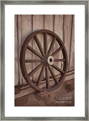 An Old Wagon Wheel Framed Print