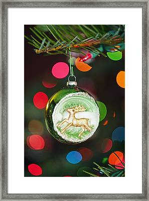 An Ornament With A Reindeer Hanging Framed Print by Craig Tuttle