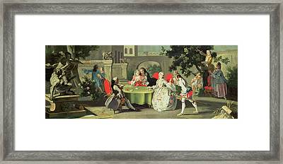An Ornamental Garden With Elegant Figures Seated Around A Card Table Framed Print by Filippo Falciatore