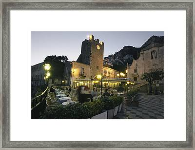 An Outdoor Cafe-restaurant With Diners Framed Print by Richard Nowitz
