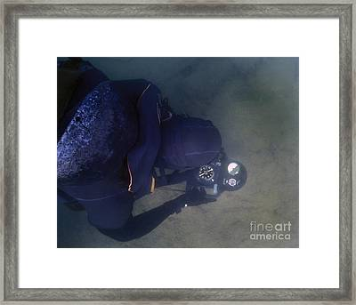 An Over The Shoulder View Of A Navy Framed Print by Michael Wood