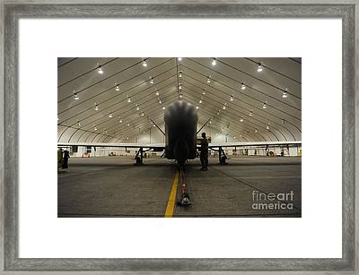 An Rq-4 Global Hawk Unmanned Aerial Framed Print by Stocktrek Images