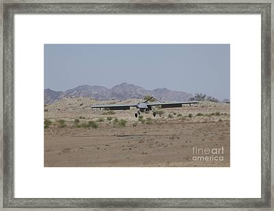 An Rq-7b Shadow Unmanned Aerial Vehicle Framed Print by Stocktrek Images