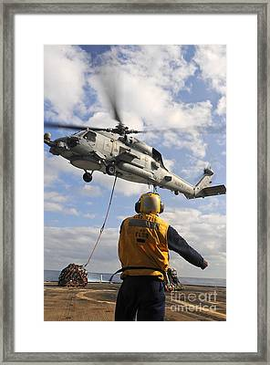 An Sh-60b Sea Hawk Helicopter Releases Framed Print