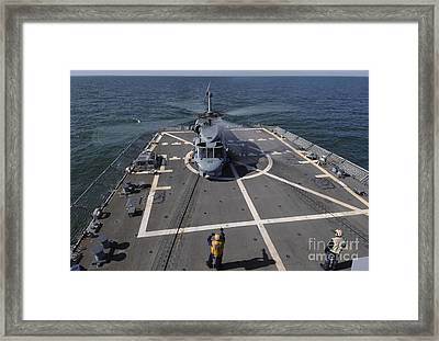 An Sh-60b Sea Hawk Lands On The Flight Framed Print by Stocktrek Images