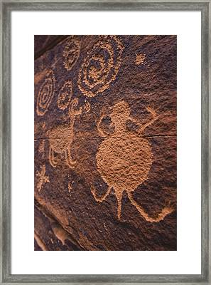 Ancient Anasazi Rock Art On Red Framed Print by Ralph Lee Hopkins