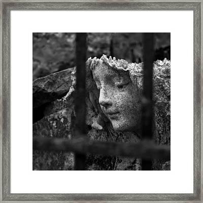 Angel In Bars Framed Print by David Waldo
