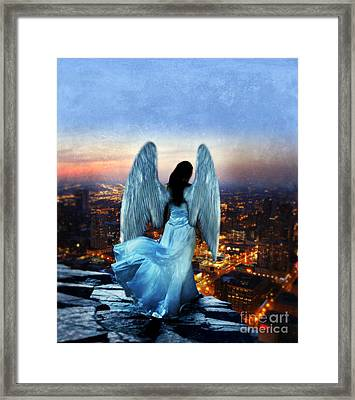 Angel On Rocky Ledge Above City At Night Framed Print by Jill Battaglia