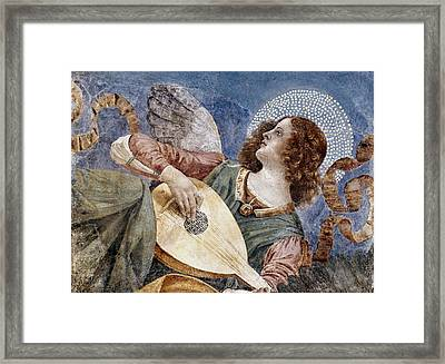 Angel With A Lute Framed Print by Granger