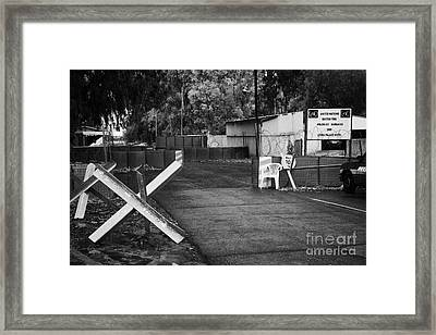 anti tank traps at entrance to UN buffer zone sector two wolseley barracks and ledra palace hotel Framed Print by Joe Fox