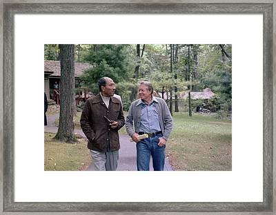 Anwar Sadat And Jimmy Carter Walking Framed Print by Everett