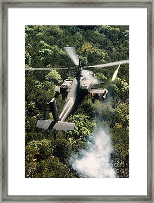 Apache Helicopter Firing Framed Print by Stocktrek Images