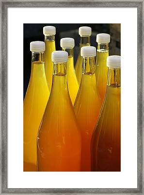 Apple Juice In Bottles Framed Print by Matthias Hauser