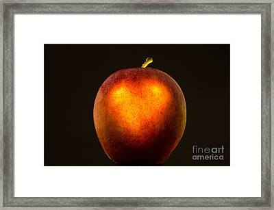 Apple With A Illuminated Heart Framed Print by Mats Silvan