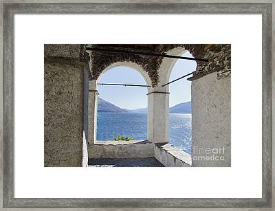 Arch And Lake Framed Print