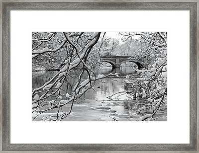 Arch Bridge Over Frozen River In Winter Framed Print