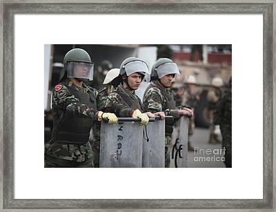 Argentine Marines Dressed In Riot Gear Framed Print by Stocktrek Images