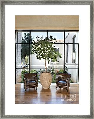 Armchairs In Front Of A Large Window Framed Print by Noam Armonn
