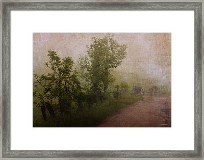 Arriving Home Framed Print by Ron Jones