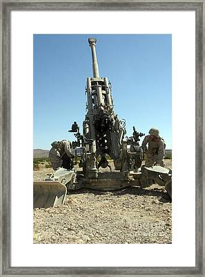 Artillerymen Manning The M777 Framed Print by Stocktrek Images