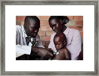 Assessing A Sick Child Framed Print