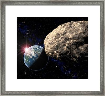 Asteroid Approaching Earth Framed Print by Roger Harris