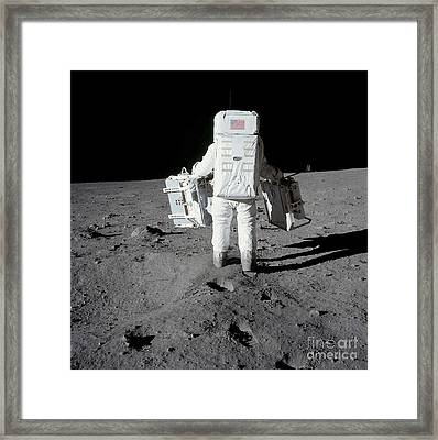Astronaut Carrying Equipment Framed Print by Stocktrek Images