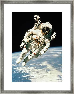 Astronaut In Space Framed Print by NASA / Science Source