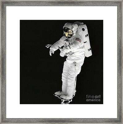 Astronaut Stands On A Portable Foot Framed Print by Stocktrek Images