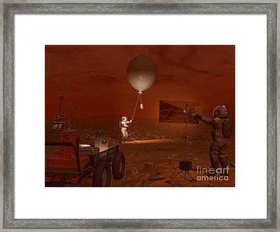 Astronauts Release A Weather Balloon Framed Print by Walter Myers