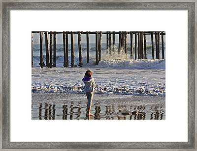 At The Pier Framed Print