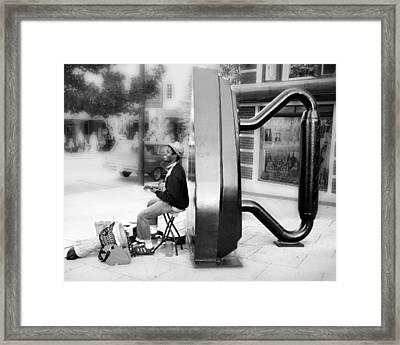 Atown Street Musician Framed Print