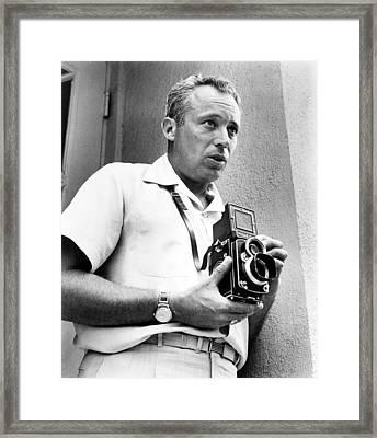 Author Leon Uris Turns Photographer Framed Print by Everett