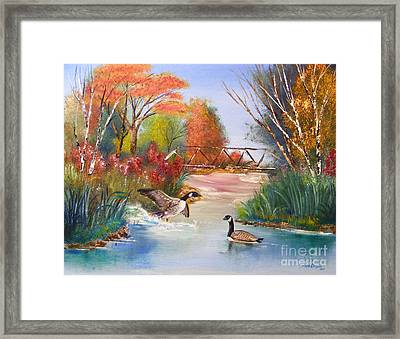 Autumn Geese Framed Print by Crispin  Delgado