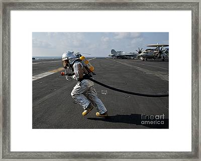 Aviation Boatswain's Mate Carries Framed Print by Stocktrek Images